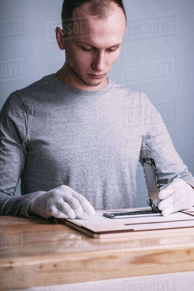 Young male technician repairing mobile phone at electronics store Royalty-free stock photo