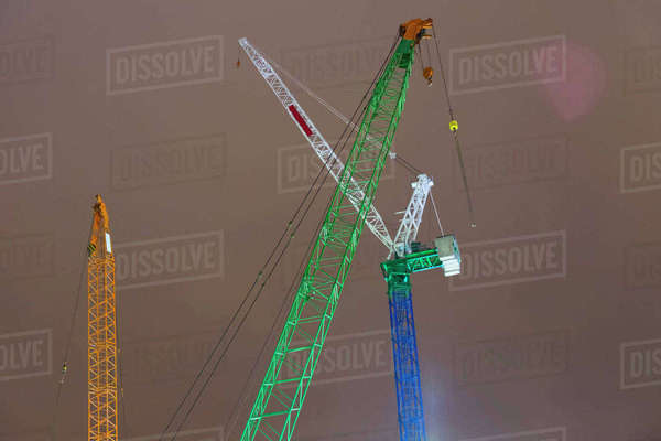 Low angle view of construction cranes against sky Royalty-free stock photo