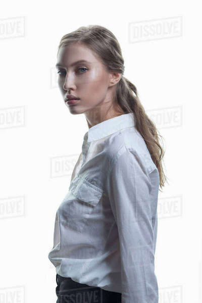 Side view portrait of beautiful fashion model against white background Royalty-free stock photo