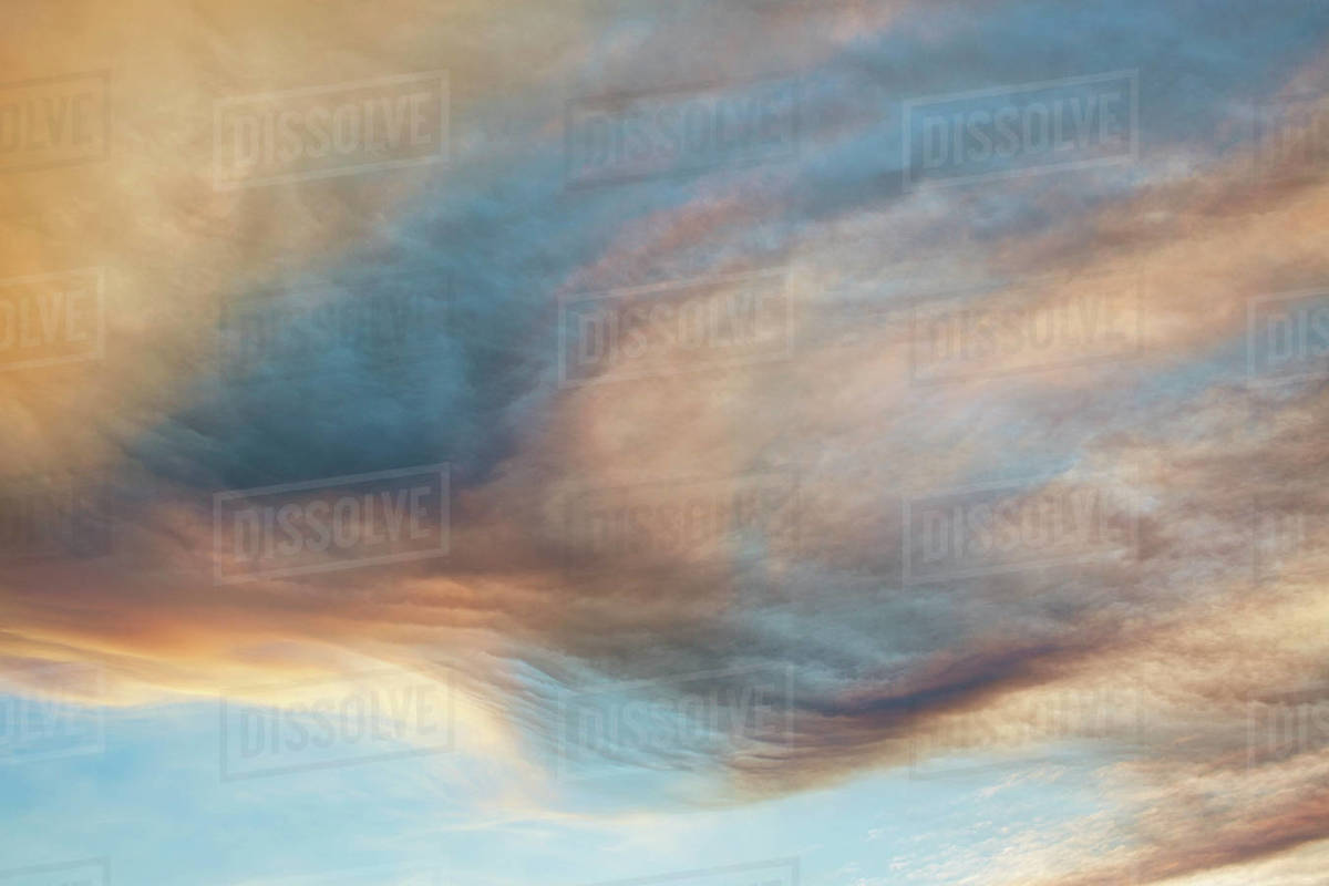 Clouds forming swirling pattern in dramatic sky Royalty-free stock photo