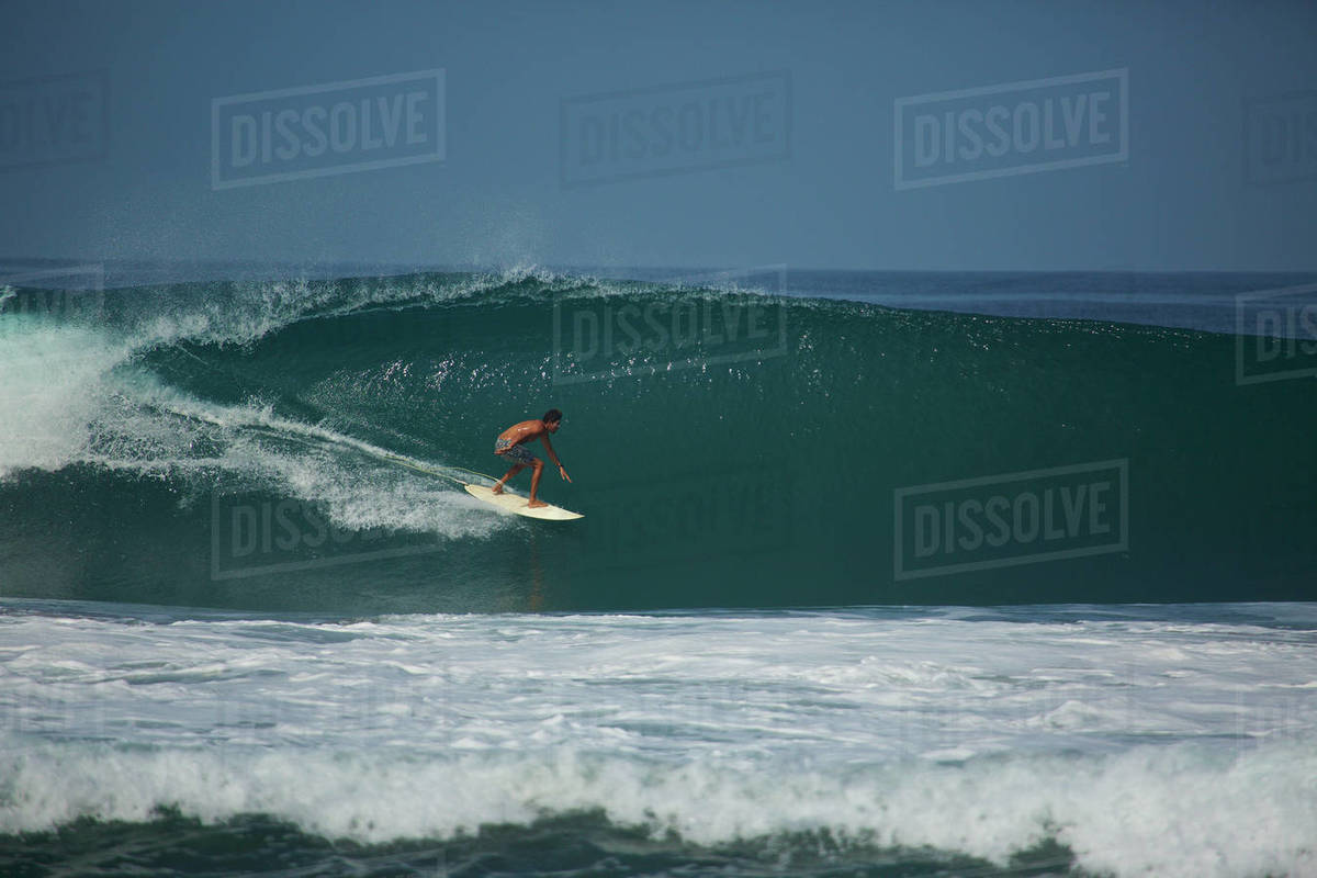 Male surfer riding ocean wave Royalty-free stock photo