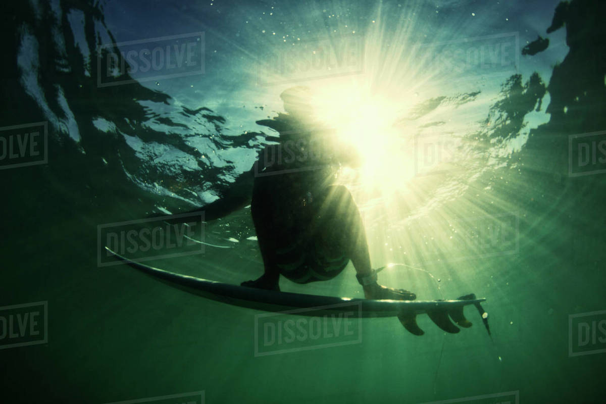 Underwater ocean view male surfer balancing on surfboard Royalty-free stock photo