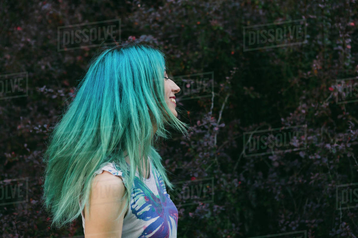 Profile carefree young woman with blue hair Royalty-free stock photo