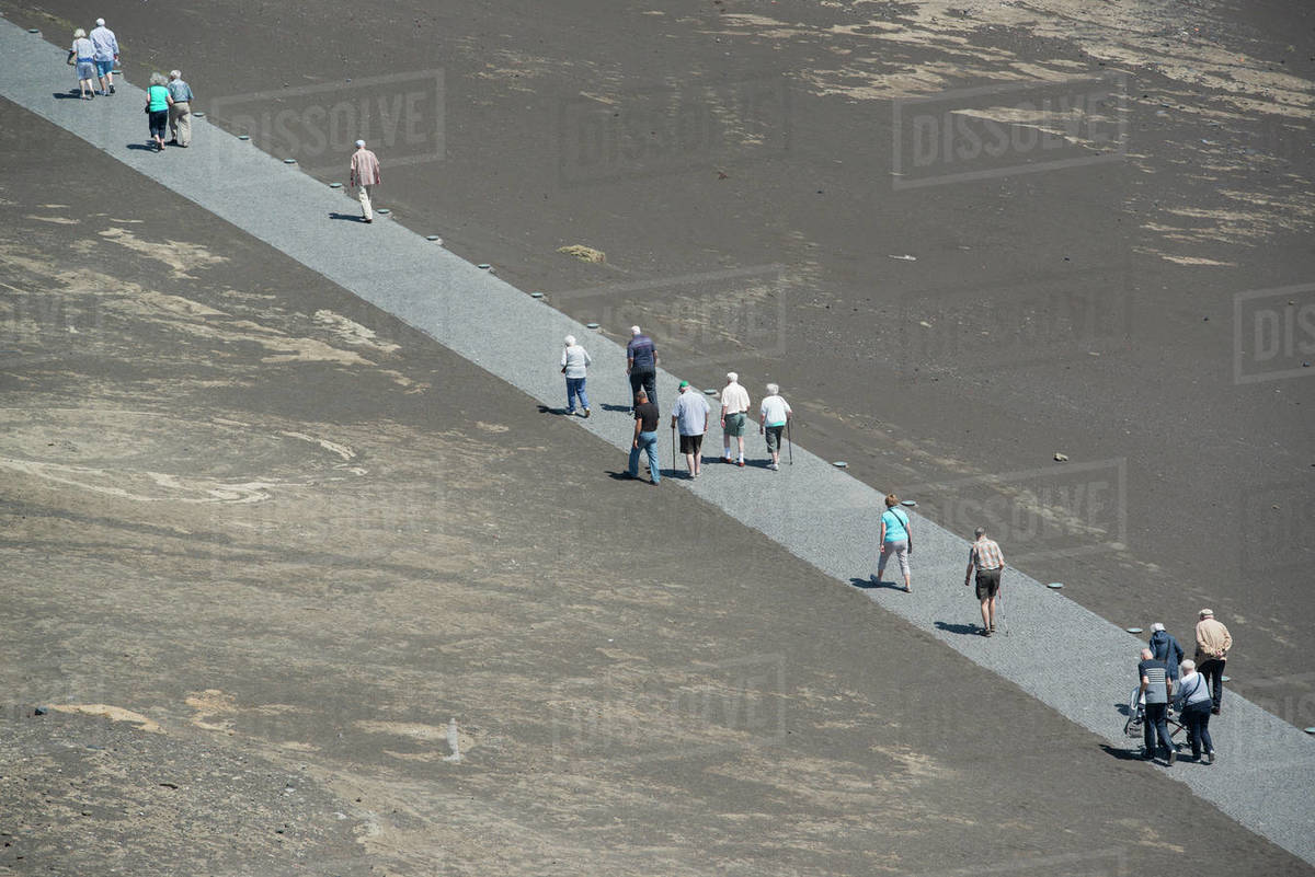 Tourists walking along volcano path, Faial Island, Azores, Portugal Royalty-free stock photo