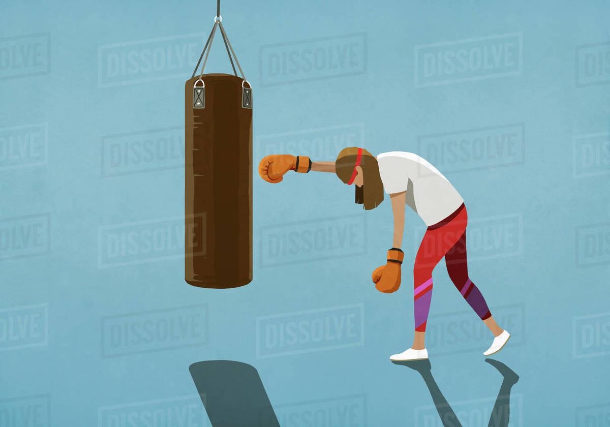 Tired woman boxing at punching bag Royalty-free stock photo