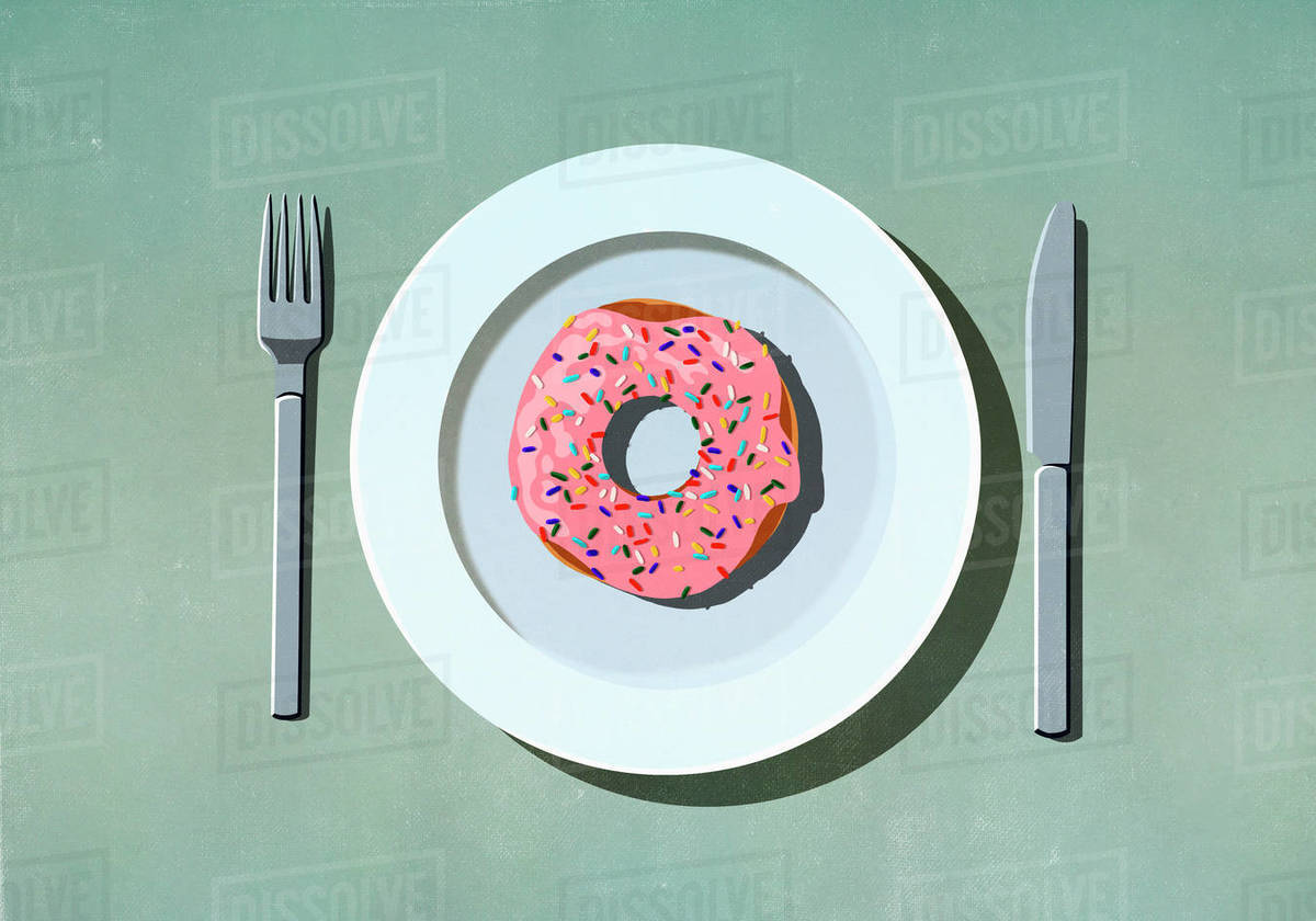Pink donut with sprinkles on plate Royalty-free stock photo