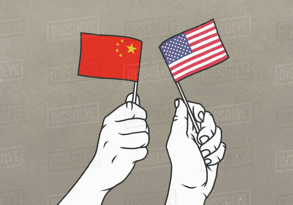 Hands waving small American and Chinese flags Royalty-free stock photo
