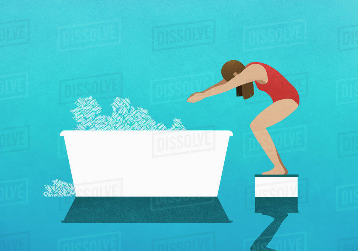 Woman on diving block preparing to dive into bubble bath Royalty-free stock photo