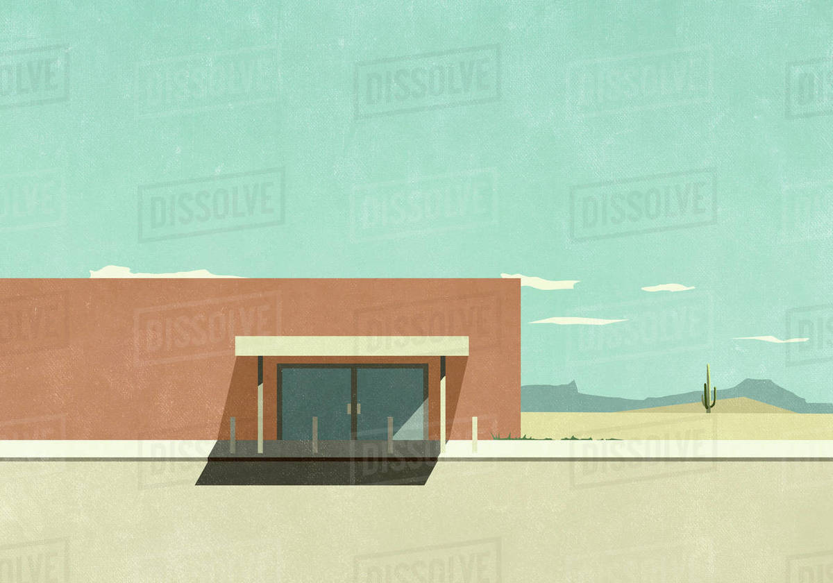 Warehouse building in sunny desert landscape Royalty-free stock photo