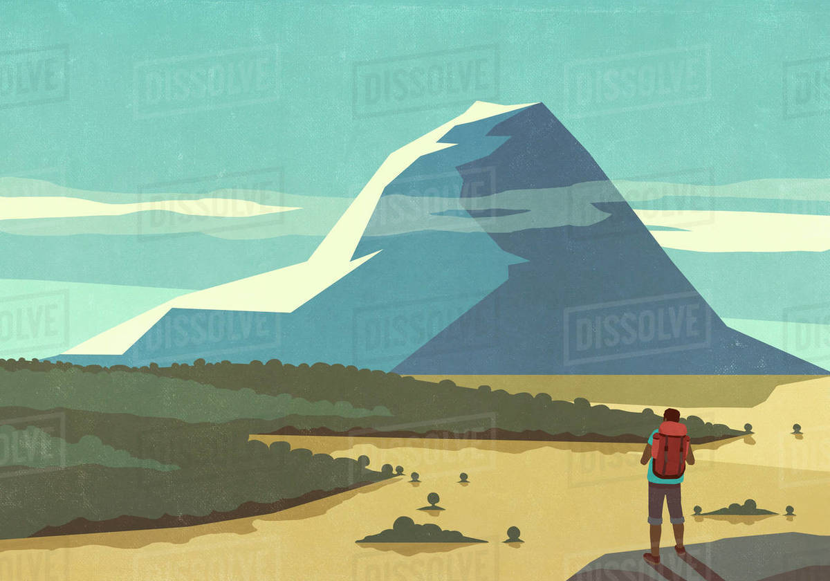 Male backpacker enjoying sunny scenic mountain landscape view Royalty-free stock photo
