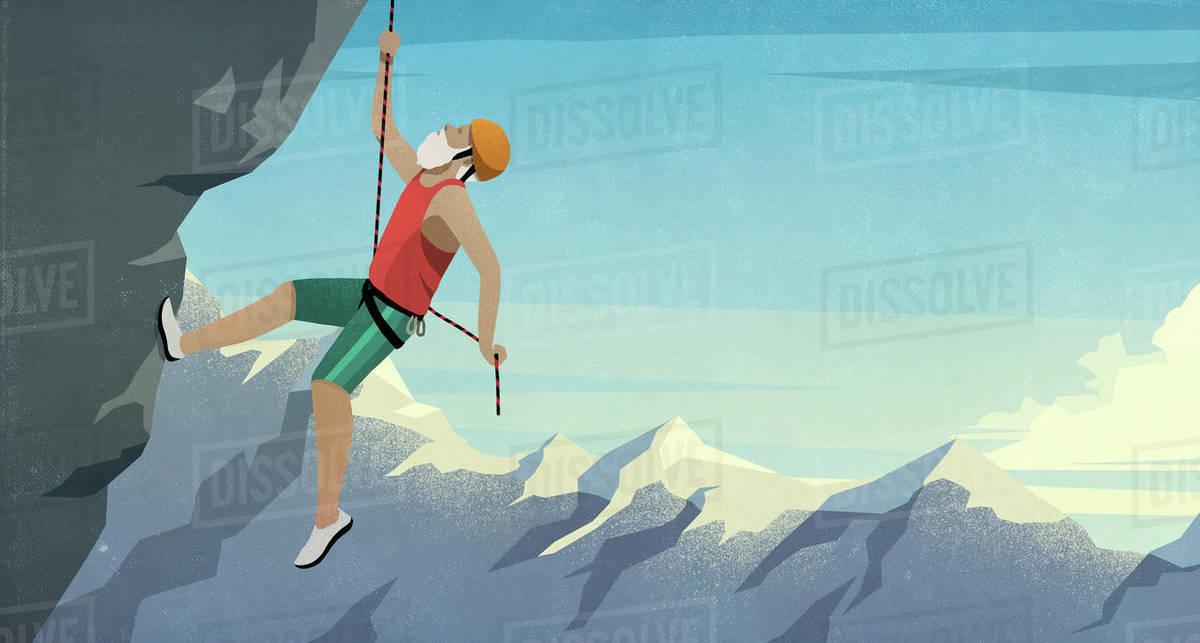 Senior male mountain climber scaling rock face Royalty-free stock photo