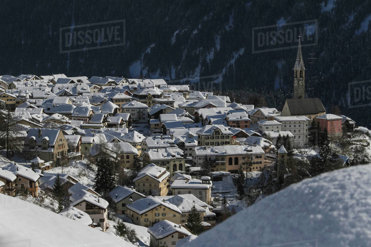Scenic view sunny snow covered village rooftops, Sent, Canton of Grisons, Switzerland Royalty-free stock photo
