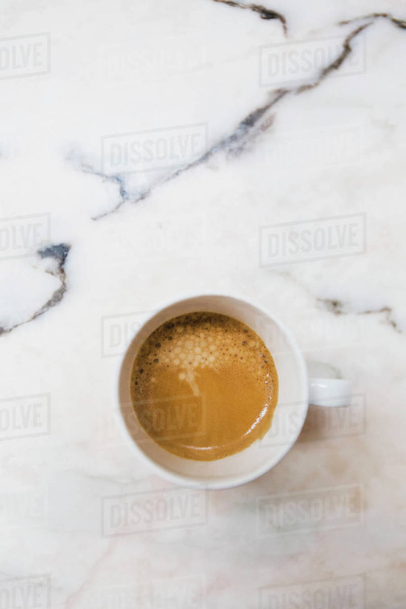 View from above espresso in mug on marble surface Royalty-free stock photo