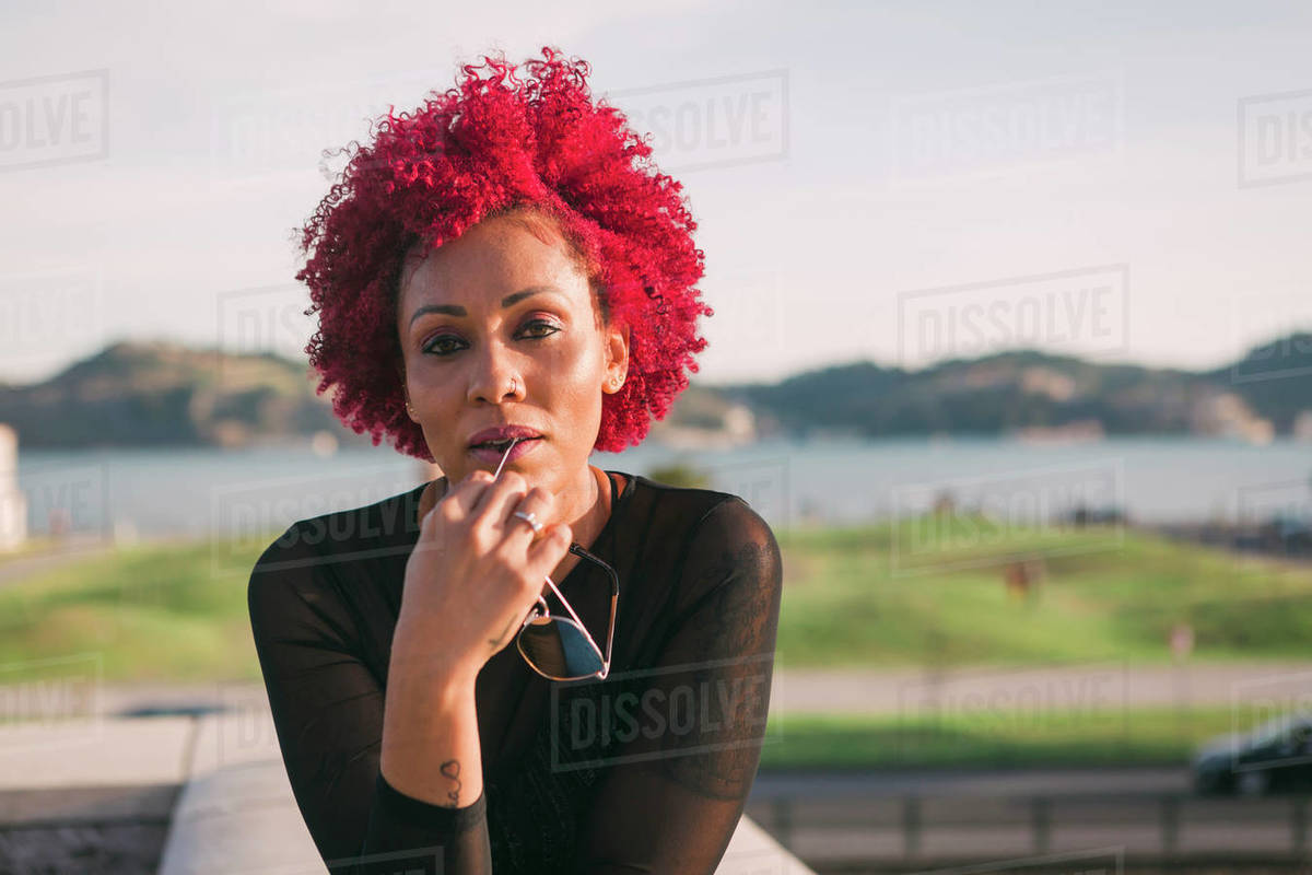Portrait confident, serious woman with red hair Royalty-free stock photo