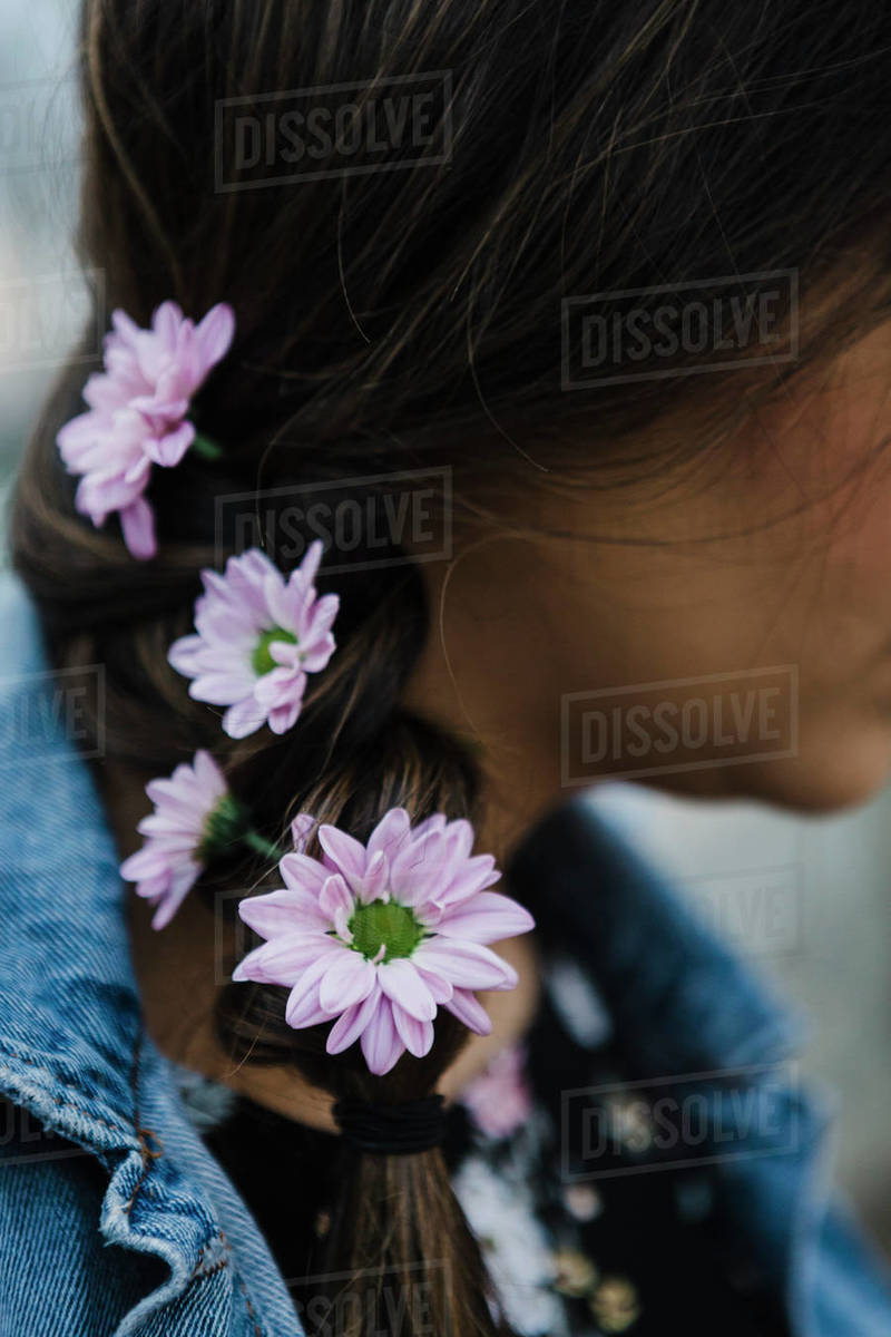 Close up woman with purple flowers in braided hair Royalty-free stock photo