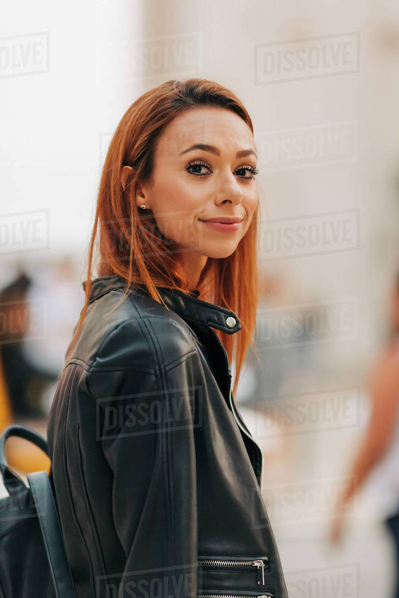 Portrait confident young woman in leather jacket Royalty-free stock photo