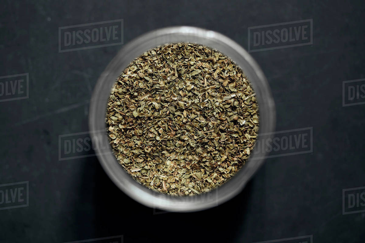 View from above oregano flakes in spice jar Royalty-free stock photo