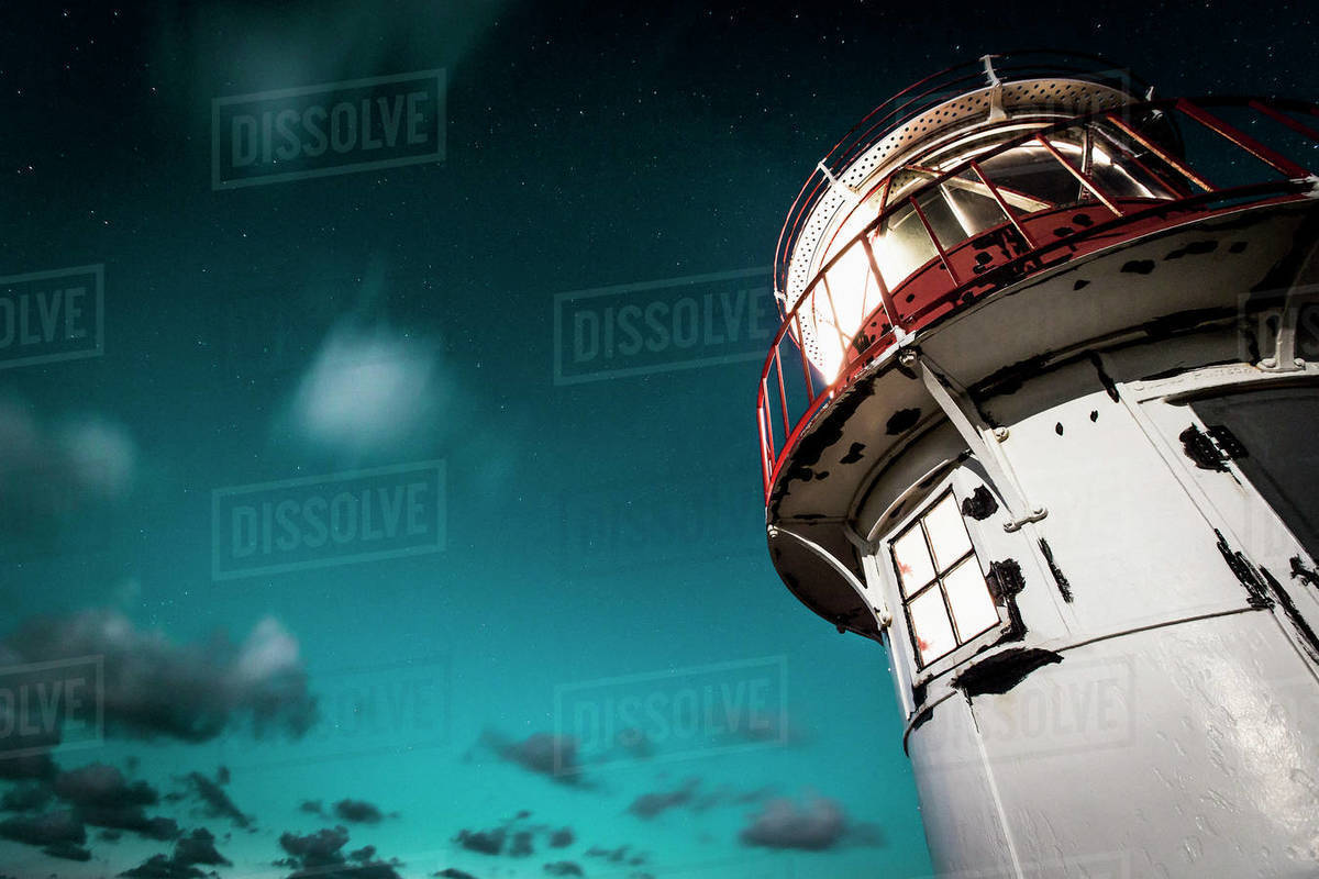 Lighthouse under cloudy night sky, Norddorf, Schleswig Holstein, Germany Royalty-free stock photo