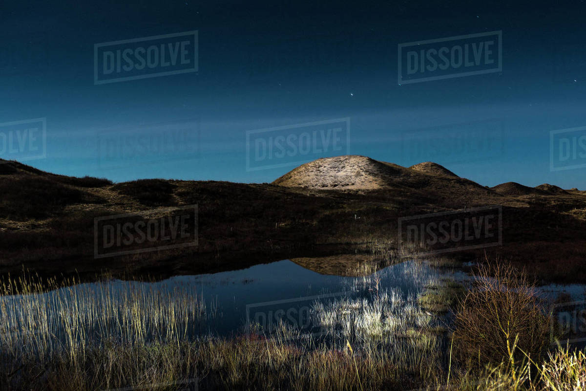 Tranquil illuminated dunes at night, Norddorf, Schleswig Holstein, Germany Royalty-free stock photo