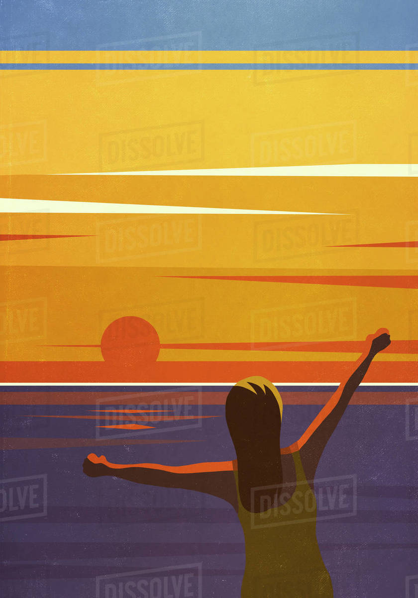 Carefree woman with arms outstretched enjoying sunset view over ocean Royalty-free stock photo