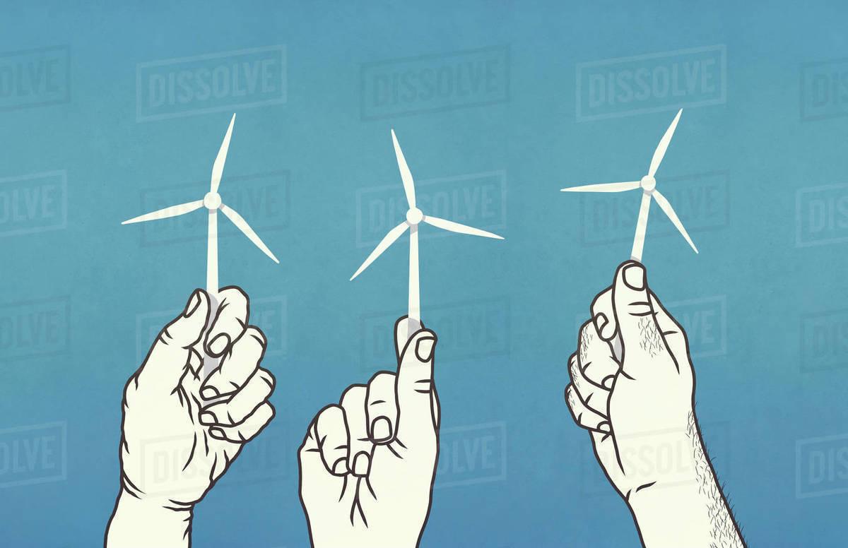 Hands holding tiny wind turbines Royalty-free stock photo