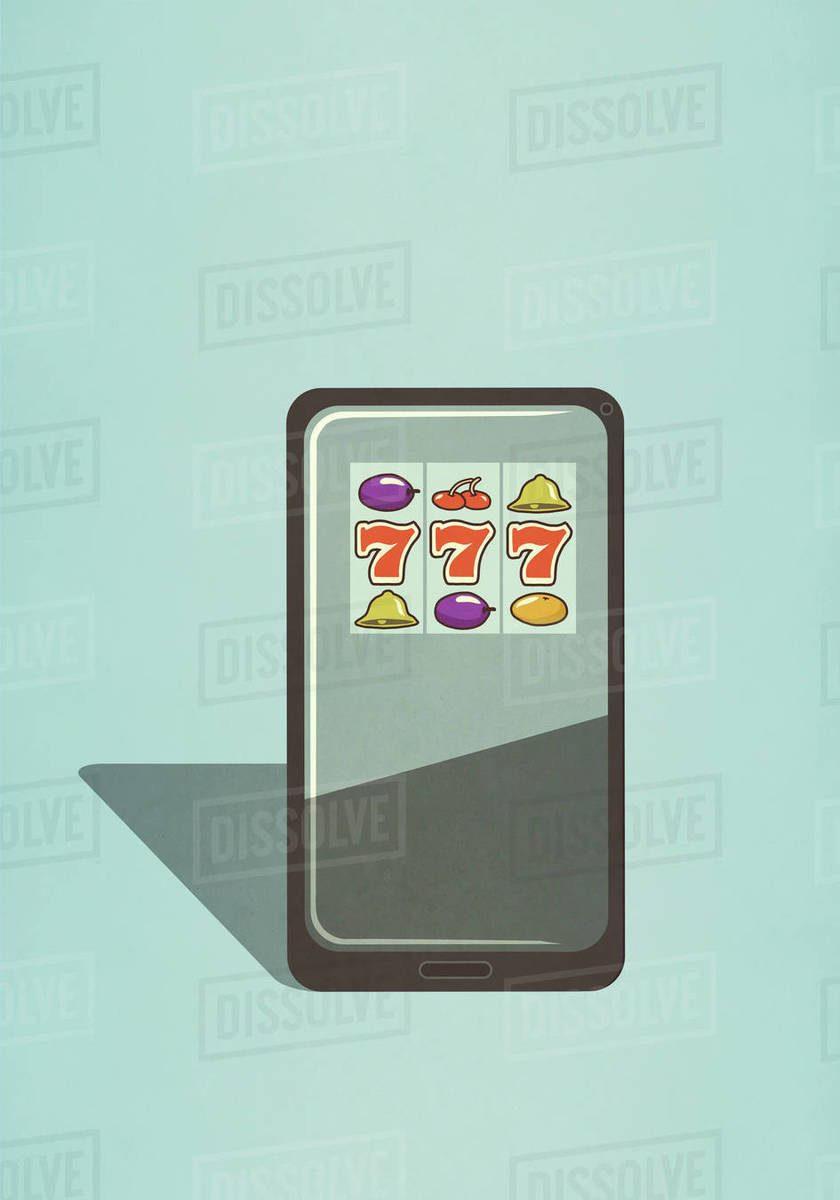Slot machine game on smart phone screen Royalty-free stock photo