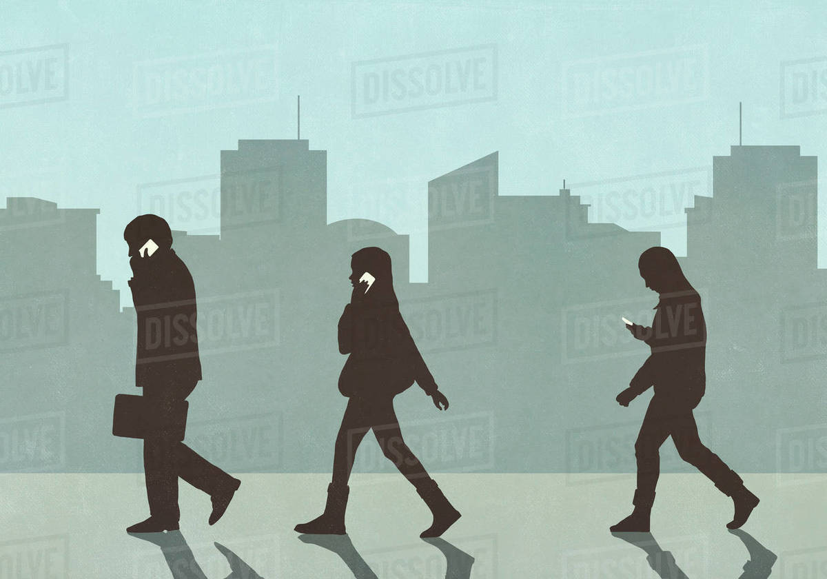 Pedestrians walking and using smart phones in city Royalty-free stock photo