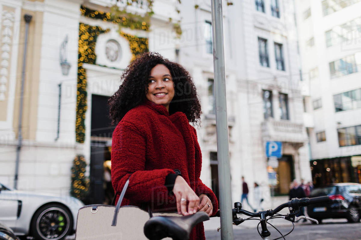 Happy young woman on urban street Royalty-free stock photo