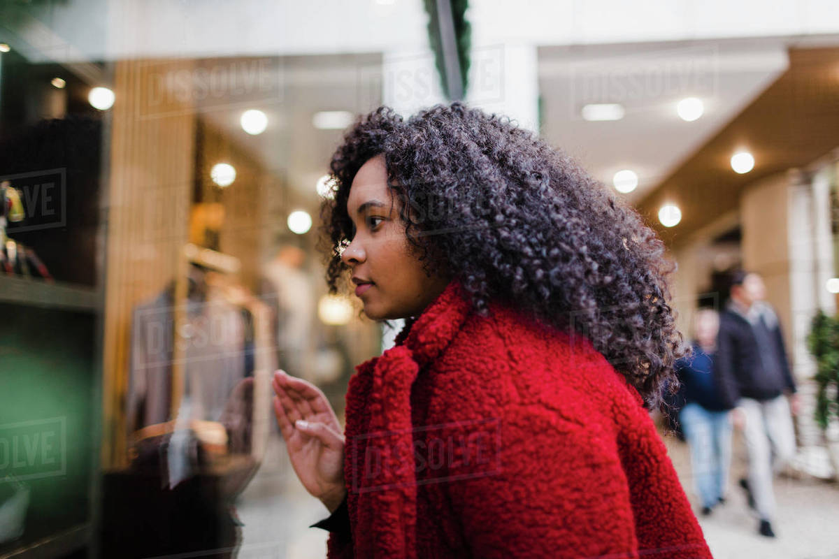 Young woman window shopping in mall Royalty-free stock photo