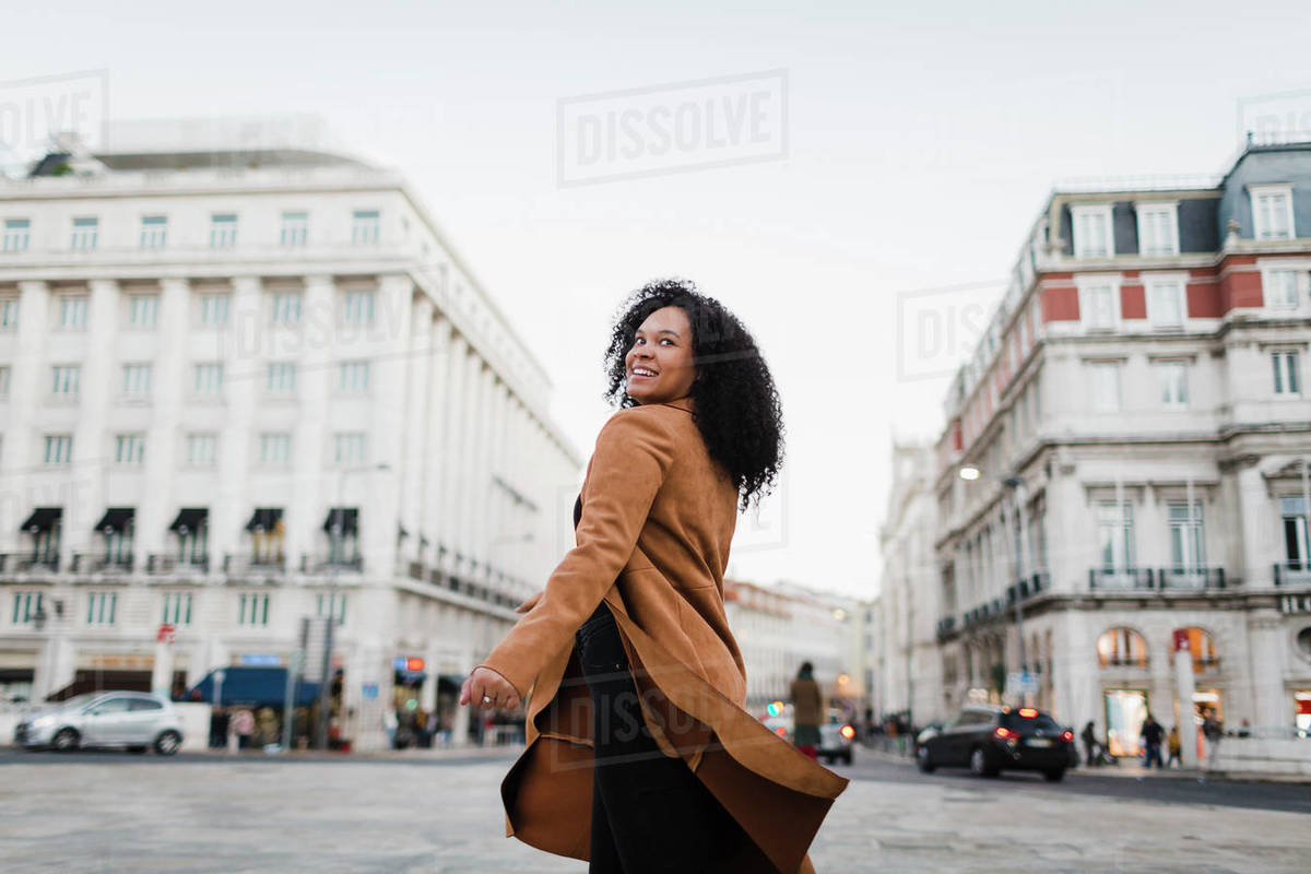 Portrait carefree young woman on urban street, Lisbon, Portugal Royalty-free stock photo