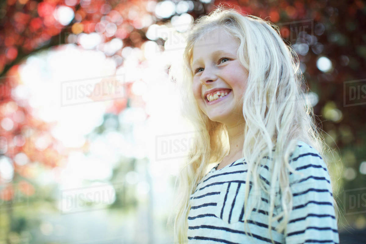 Confident, happy girl smiling in autumn park Royalty-free stock photo
