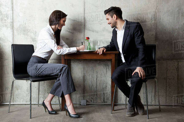 A businessman and businesswoman having a meeting in a modern office Royalty-free stock photo