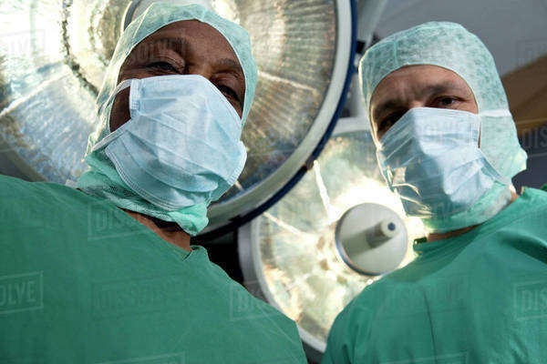 Two surgeons looking down at a patient, personal perspective Royalty-free stock photo